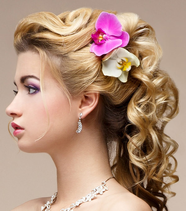 updo hairstyle with loose curly back