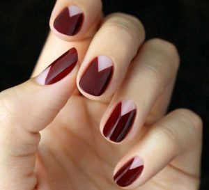 French manicure with garnet and gold tips