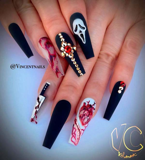Cool Halloween Nails With Studded Skulks And Cross #nails #Halloween nails #trendypins