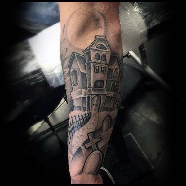 A Tattoo of a Haunted House Surrounded by Tombstones #Halloween #tattoos #trendypins