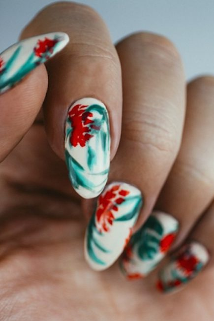 Christmas Flowers on a White Base of Nails