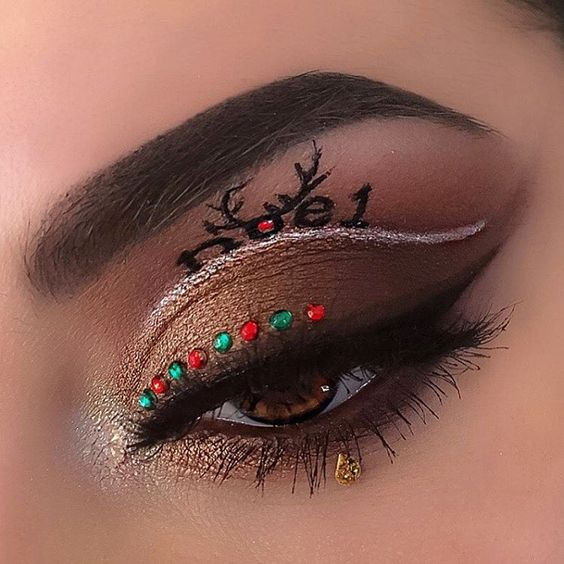 Christmas Reindeer, Silver Eyeliner, and Red and Gold Beads #Christmas #makeup #beauty #trendypins