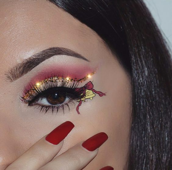 Gold Bells and Christmas Ribbon with Glowing Golden Eyeshadows #Christmas #makeup #beauty #trendypins