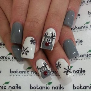 Grey and White Themed Christmas Nails with Reindeer and Black Snowflakes