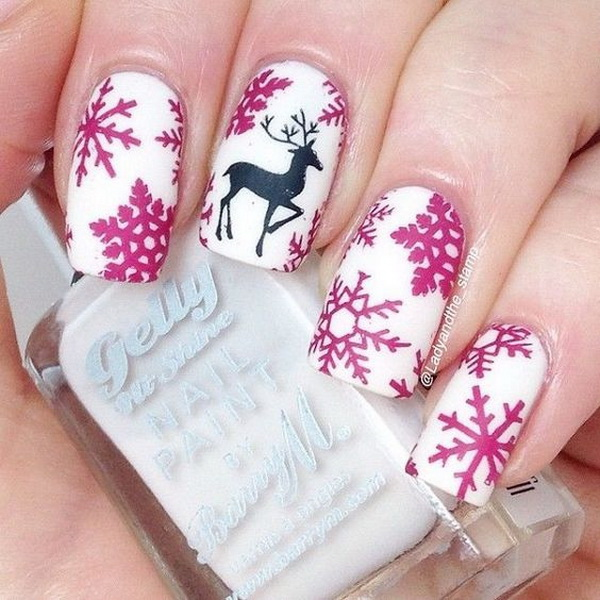 Snowflakes and a Reindeer on White Matte Base Christmas Nails #Christmas #nails #trendypins