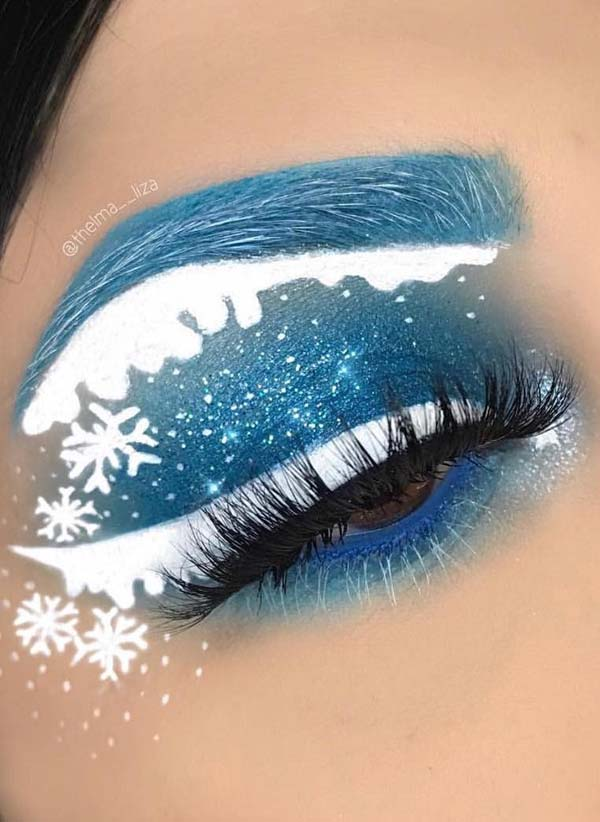 Snowing White and Blue Eyeshadows and Snowflakes #Christmas #makeup #beauty #trendypins