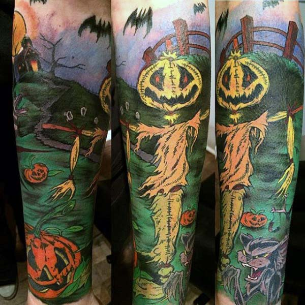 This Piece Stretches Around Your Whole Forearm, Which Features a Scarecrow, Next to a Fence #Halloween #tattoos #trendypins